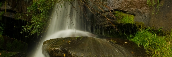 This image captures the title of the name of the falls living waters