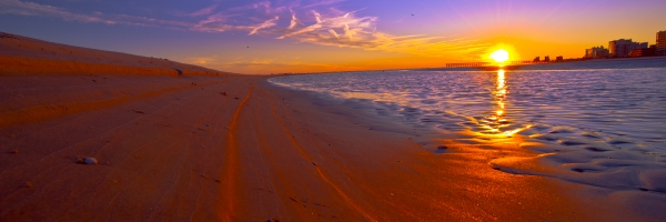 I have been to this spot many times but this time the sand bar curved around to the sunset I love this image